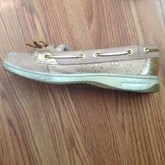 Flower sperrys Worn a few times. There is some dirt on them but it would come off easily if you wash it. There pretty much like new. They have cute little flowers on the sides and gold laces. Sperry Top-Sider Shoes Flats & Loafers