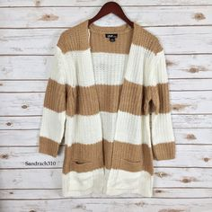 Striped chunky knit cardigan Brand: Love by Chesley  Size:L(best fit M) New Colors:White/Beige  Open front No zipper/buttons  2 front pockets Oversized Chunky knit  Long sleeves  Striped  100% Acrylic No Trade Sweaters Cardigans