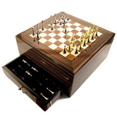 Slip your favorite cigar from this 75-cigar Spanish cedar humidor case and enjoy a game on its chess board top with gold- and silver-colored chess pieces. Activate the built-in humidor to maintain the