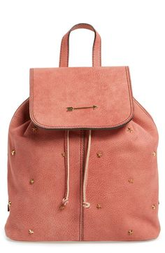 Totally crushing on this pink drawstring backpack with gold spikes and arrow emblem.