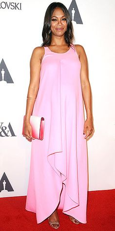 ZOË SALDANA Proudly flaunting her baby bump, the star makes a simply chic color statement in a sleeveless Dior gown and a cool ombré clutch at the Academy of Motion Picture Arts and Sciences' Hollywood Costume opening party in L.A.