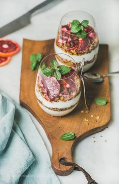 Healthy breakfast with yogurt granola orange layered parfait by 2enroute