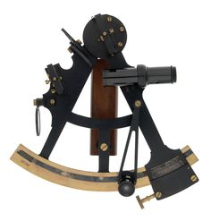 The sextant has a black-lacquered brass Dollond-pattern frame and a wooden handle. The tangent screw and clamping screw are positioned on the back of the index arm. The instrument has two green shades and one green horizon shade. Index- and horizon-glass adjustment is made by screws and capstan screws. Attached to the sextant is a magnifier on a 100mm swivelling arm Read more at http://collections.rmg.co.uk/collections/objects/8415.html#YSQldlHKytZQSRrV.99