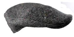 Irish on Grand: Salt and Pepper Donegal Touring Cap made by Hanna Hats in Donegal. The Plain Tweed Cap is the style most frequently worn in Ireland. It is handcrafted and can be worn by young and old, male and female. Consistently our number one seller and available in a selection of tweeds.
