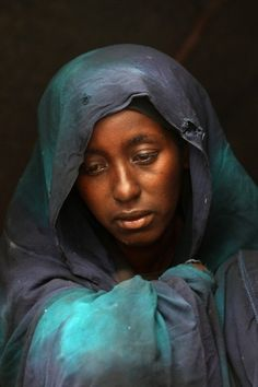 Safia Adem mourns the death of her son Hamza Ali Faysal, 3, in a camp of displaced Somalis within the rubble of the Cathedral of Mogadishu on August 13, 2011 in Somalia. The malnourished child died two weeks after fleeing with his family from famine and drought. (Photo by John Moore/Getty Images)