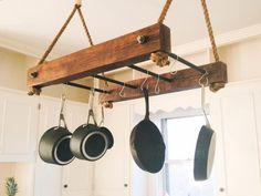 This solid, handcrafted wood and steel pot rack is the perfect centrepiece for your kitchen. With space to hang 8 pots and utensils, this heavy Kitchen Rack, Diy Kitchen, Kitchen Decor, Pot Hanger Kitchen, Kitchen Island Pot Rack, Hanging Pots Kitchen, Kitchen Storage, Kitchen Ideas, Rustic Wood
