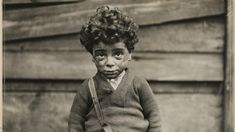 This picture by Lewis Hine shows the hardships children of the industrial revolution faced.
