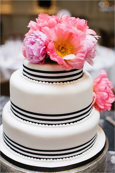 modern black and white wedding cake ideas. see more of these modern wedding ideas at http://www.weddingchicks.com/2013/08/27/modern-london-wedding/