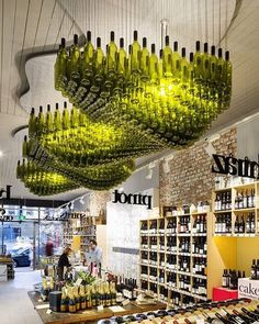 """Wine Republic in Melbourne, Australia installed an lighting sculpture nicknamed the """"Wine Cloud."""" The shop design (by Red Design Group) was shortlisted for the Australian Interior Design Awards. Australian Interior Design, Interior Design Awards, Retail Interior, Wine Shop Interior, Deco Restaurant, Restaurant Design, Restaurant Lighting, Western Restaurant, Restaurant Interiors"""