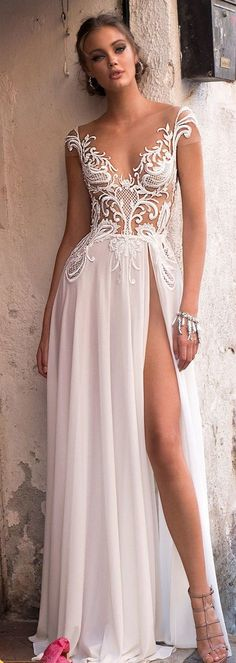 MUSE's sophisticated style wedding dress... slit goes a little too high for my taste. But it's a pretty dress