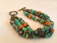 Love the Turquoise and Amber beads in this bracelet. does not link.