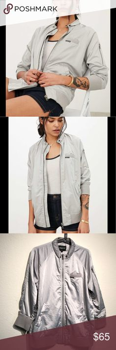 Members Only Grey Satin 3/4 Sleeve jacket Be part of the it club with this silver/grey satin 3/4 sleeve bomber jacket.  It's a boss girl, downtown chic vibe staple.  It's an updated silhouette and is ready for you to rock in on your runway.  Condition 9/10 Members Only Jackets & Coats