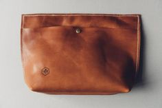 hustle & hide co // the oversized abey clutch in horween cognac leather