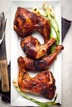 Easy Mexican Roadside Chicken - Chicken marinated in ground ancho, orange juice, and garlic, then oven baked until crispy. #mexican #dinner