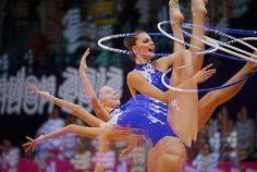 Bulgaria's Silviya Miteva competes using the hoop in the individual all-around rhythmic gymnastics qualification round