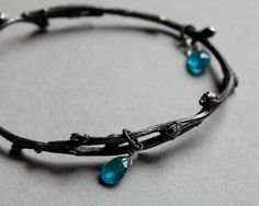 Willow twig bangle, sterling silver with apatite drops, blackened twig jewelry. $280.00, via Etsy.