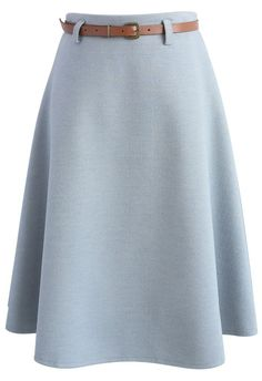 A mild slay is in the forecast today Chicwishers! This wool-blend A-line skirt offers a dose of subtlety and simplicity with its soft dusty blue hue and stylish skinny belt. - Belt accompany - Concealed back zip closure - Lined - 35% Wool, 65% Viscose - Hand wash Size (cm) Length Waist XS 67 66 S 67 70 M 67 74 L 67 78 Size (inch) Length Waist XS 26.5 26 S ...