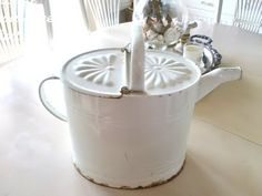 Hi Friends , Happy White Wednesday ♥ Isn't this the most wonderful vintage white French Enamel Watering Can I love the design it holds .