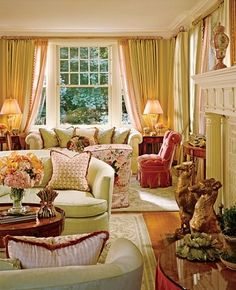 """The living room """"is feminine and inviting,"""" says Watson. A pair of 18th-century Pembroke tables, from Kentshire Galleries, flank the sofa at rear. Pink chintz on chair, Lee Jofa. Brunschwig Fils lampshade plaid, drapery sheer and green sofa fabric. Stark carpets."""