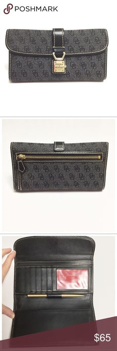 "{ Dooney & Bourke } Signature Checkbook Wallet ✅Questions, offers thru offer button 🚫Trades, holds, $$ talk in comments plz D&B Wallet  - Black signature print canvas, black leather trim, gold hardware  - Flap w/ pushlock clasp closure  - Black leather interior, red pocket lining  - 6 cc slots, ID window, 3 bill pockets  - Removable checkbook cover w/ bill pocket  - Full sized: about 7.5"" x 4"" x 1""  - Pre-loved, corners & edges are perfect, pen writes, interior has very minor scratches…"