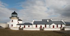 Clare Island Lighthouse is located off Ireland's western Atlantic coast. This luxury Lighthouse hotel offers a unique experience to its guests with breathtaking sea views of the Wild Atlantic Coast Lighthouse Hotel, Clare Island, Blue Books, Belfast, Lonely Planet, Lighthouses, Hotel Offers, Taj Mahal, Ireland