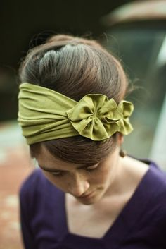 Rustic Green Rosette     A soft stretch headband made extra special with a hand stitched rosette embellishment. A flattering style! May also be bunched for a sleek look. Clasp closure for easy wear. Pictured in Rustic Green but also available in an array of beautiful colors