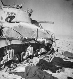 M4 Sherman and New Zealand Tank Crew Rests beside US tank in Africa desert