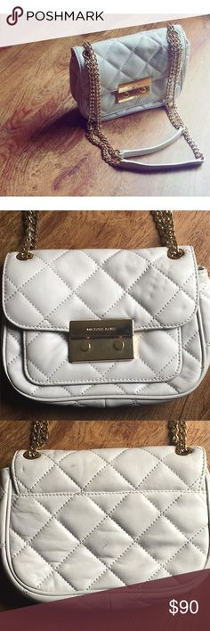 Michael Kors Sloan Quilted Crossbody while I love it to bits, it doesn't fit my style. I'm so sad to say goodbye! It's an off-white cream color. Can be worn on the shoulder or crossbody. The leather is showing some signs of age, but the interior is in excellent condition. There is a red mark in one of the pockets, but it's very small. Please look carefully at the pictures to see the condition. I try my best to show items as accurately as possible :) Michael Kors Bags Crossbody Bags
