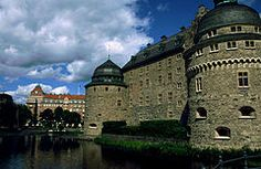 Örebro Castle is a medieval castle fortification in Örebro, Närke, Sweden. It was expanded during the reign of the royal family Vasa (House of Vasa) and finally rebuilt about 1900. The castle lies on an island in river Svartån. Some of the rooms are used as classrooms for pupils from Karolinska Skolan.