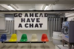 """""""Go Ahead Have a Chat"""" in laundry room of dorm with colorful seating"""