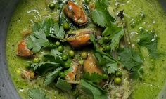 Bowl of clustered mussels, coconut and noodles