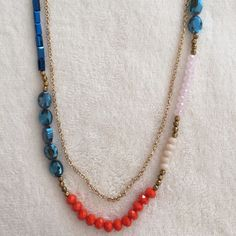 STUNNING necklace NWOT This necklace is truly stunning. The blue sparkles and picks up on the other colors throughout. I just love it! Colors are coral, blue, gold tone and white. Jewelry Necklaces
