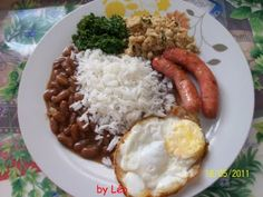 Rice and beans.  In Brazil is tradition put together all the foods in the same plate, combination of rice and beans is always present in the lunch time and dinner, together with variations of meat, egg, salad and others, but beans and rice is ever present.