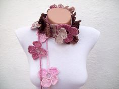 This would be perfect right now. http://www.etsy.com/listing/79699860/hand-crochet-lariat-scarf-pink-brown?ref=tre-1852595605-12