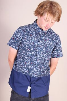 http://www.foxandfeather.co.uk/collections/mens-new-in/products/native-youth-mono-floral-print-shirt  Native Youth Mono Floral Print Shirt. Blue colour block short-sleeve shirt with white floral print.