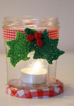 #Holiday candle holder: used jam jar, tea light, ribbon and Holly leaves by Attic24.Typepad.com  by dutch blue, via Flickr