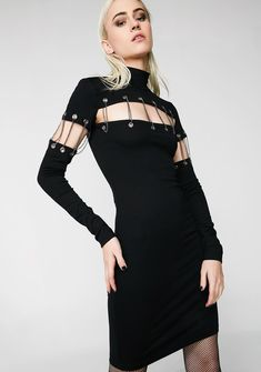 Can't Chain Me Bodycon Dress cuz no one can stop ya, bb. Make moves with this long sleeve bodycon dress that has a mock neckline, silver eyelet N' chain details on the front N' sleeves and a button closure.