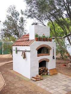 I am going to build one of these! Masterly tail oven design, modified building.