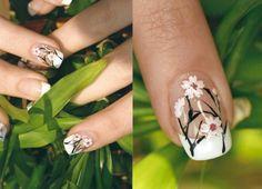 http://www.naildesigners.net/wp-content/uploads/2011/05/Cherry-Blossoms-Nails.jpg