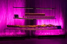 Floating dessert station with fuschia uplighting #MiamiCatering