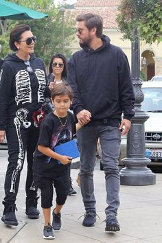 Scott Disick wearing Saint Laurent Original Low Waisted Skinny Jean in Washed Grey Stretch Denim and Adidas Ultra Boost Uncaged Sneakers