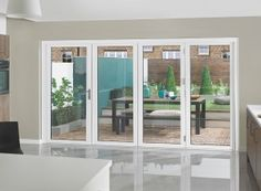 Supreme White Aluminium bi-fold doors made from thermally broken aluminium with thick doors and triple glazed units making this door set energy efficient. Folding Glass Patio Doors, Folding Doors, Glass Doors, Porch Windows, Windows And Doors, Kitchen Windows, House Extension Design, House Design, External Bifold Doors