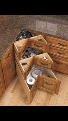 Corner kitchen drawers-love this more than the deep corner cabinet or the flimsy not so organizable lazy susan