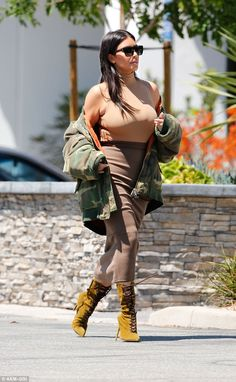Borrowing Kanye's clothes? She completed her look with a large camouflage jacket which looked like something straight from Kanye West's Yeezy collection