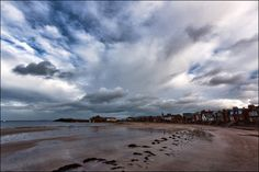 North Berwick, East Lothian, Scotland. Houses right on the beach. Were they built that close to the edge when built? Great cloud formation too.
