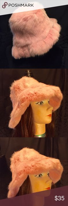 "New pink rabbit fur hat Crowncap Beautiful new with tags pink rabbit fur hat. Super cute style with quilted nylon lining, hat is floppy style. inside dimensions are approximately 23"" height 5.5"" hat rim 2"". Crowncap Accessories Hats"