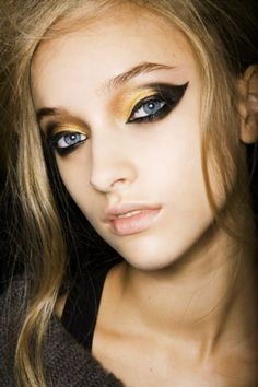 heavy black and gold...YEAH I REALLY WOULD LIKE TO BLEND THIS IN MORE AND SMOKE IT OUT WITH SOME COBALT BLUE TO BRING OUT HER EYES MORE THAN THIS HIDEOUS MAKEUP