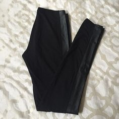 Black leggings with faux leather Faux leather stripe down side of each leg Frenchi Pants Leggings