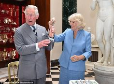 Bold move: Charles let the Duchess of Cornwall take the handle while he grasped the blade instead