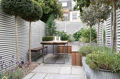 Small Patio Garden has a reclaimed wooden Bench and table and red cedar garden dividers. Discover decking and patio garden ideas from House & Garden.